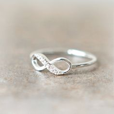 This would be an adorable engagement ring or anniversary gift. Infinity like you'll be together forever(: I want it