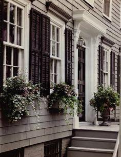 Exterior paint. Gray paint. White trim. Black shutters and front door.