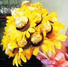 "i made my sis this bouquet of ""ferrero rocher flowers"" (silk daisies on bamboo skewers with her favorite candy ferrero rocher hazelnut chocolate as the centers) for her birthday... she loved it!"