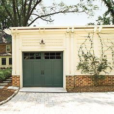 Yes, you can paint your garage door.  The garage door should accent the exterior color palette of the main home and create a cohesive appearance. | via Southern Living. Like the carriage house style garage door? Visit clopay.com.