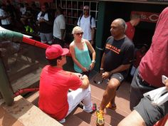 Reds 1B Joey Votto chats with @Andrew Mager Senft Bengals  head coach Marvin Lewis during their visit to Great American Ball Park today.
