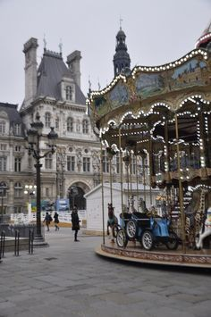 Paris, hotel de Ville - carrousel and iceskating ring at the front... by Maelo Paris