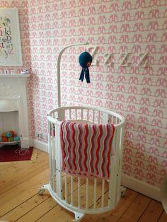 Pink modern nursery - love the round crib from @stokkebaby!