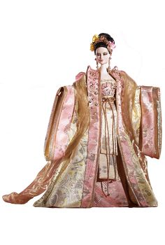 Empress of the Golden Blossom Barbie wears an opulent gown of pink and golden brocade inspired by exotic Chinese costume. The noble peony motif is elegantly featured in the lush fabrics. A golden headpiece crowns the intricate hairdo, decorated with lovely faux flowers and birds.