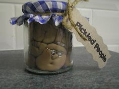 hand crafted jar of pickled people