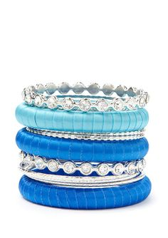 Pile on some beachy blue bangles!