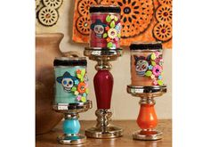 DIY Day of the Dead Candles!  Made with candle-holders from Michaels, Fabric, Glass Paints, Flower Mod Melts and Mod Podge
