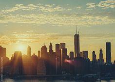 Sunset/Sunflare Over Manhattan Skyline by Kelli Kim