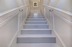 Lucite hand rails and panels on stairway via Dolce Vita