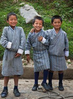 Bhutan - All boys attending school must wear the traditional knee-length robe called gho as their school uniform.