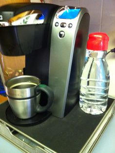 Reuse the empty coffee creamer bottle to hold water for refilling the Keurig reservoir. It sits perfectly beside a Keurig coffee maker that's placed on a K-Cup storage drawer. The cap keeps the water clean, and it's an efficient way to keep a handy refill supply - especially if your coffee center is not next to your sink.