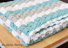 Crochet Shell Stitch Baby Blanket Pattern by The Stitchin' Mommy. Love the colors!