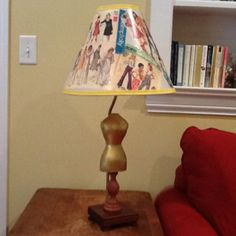 Lamp shade made from old pattern covers.