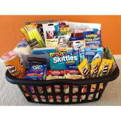 Freshman College Survival Kit - I made this for my cousin who is graduating high school. Laundry basket with favorite snacks, instant ramen, school supplies, water balloons, silly string, ear plugs, lubricant (condoms were expensive). Bought everything from Big Lots and Dollar Tree to keep it inexpensive.