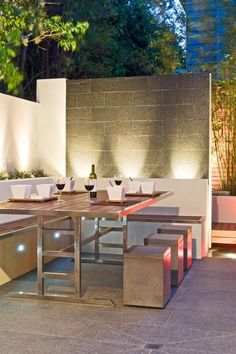Stunning Outdoor Dining Room with up lights.
