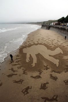 9,000 Fallen Soldiers Etched into the Sand on Normandy Beach to Commemorate Peace Day