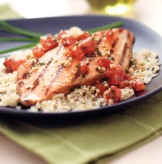 A gorgeous piece of salmon doesn't need much more than a simple sauce. Serve King Salmon with Tomatoes and Chives with steamed rice for a restaurant-quality meal.