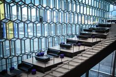 Harpa Concert Hall, Reykjavik.  I like the little platform areas off to the side of the ascending stairs :)
