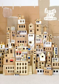 Paper house Cardboard city. Outline windows in masking tape.