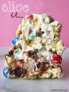 "Popcorn Cake: A ""cake"" made of buttery, salty popcorn, dotted with colorful M's and salty pretzel sticks, all held together by sticky, sweet marshmallow."