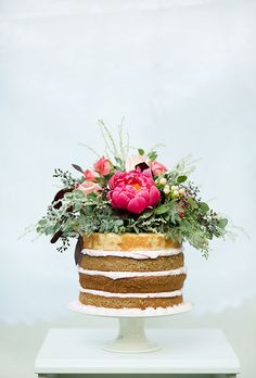 A one-tier vanilla cake with lots of flowers   Brides.com