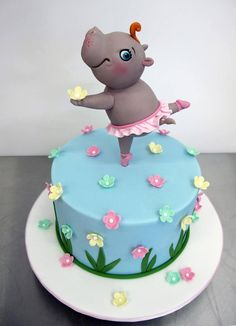 Pink, Yellow & Mint Flowers on Blue Cake with Hippo in Tutu Topper
