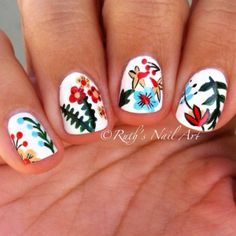 Short nails with red flower pattern by @Ruthsnailart