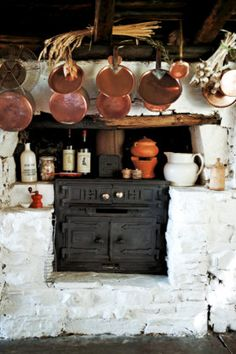 Copper pans hang above the wood stove