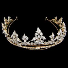 Victorian diamond set tiara, the stylised fleur-de-lys and scroll motifs graduating from the centre and set with old round brilliant-cut and rose-cut diamonds, total estimated weight 30cts, all mounted in silver grain and cut-down settings on yellow gold back, convertible into a necklace, the chain composed of a single line of rose-cut diamonds, circa 1870.