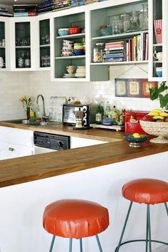 White kitchen with dark wood counters