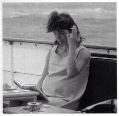 Pregnant Jackie Kennedy enjoying a cigarette, 1963.