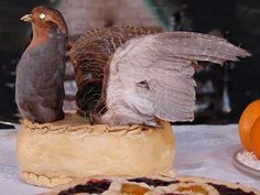 Partridge pie. Elaborate crust and real (dead) bird on top.