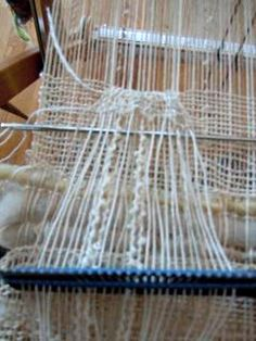 weaving additional lengths on top of what's on warp