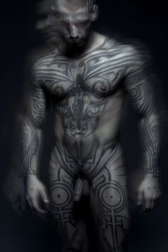Logan McCree and his amazing tattoo, he created it like a protection field taking inspiration with ancient armors, for me it's a true magick work.