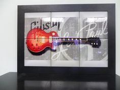 """Les Paul World Famous Gibson guitar is depicted using 6"""" ceramic tiles in vivid color which maintains its color and lusters for years to come (14 5/8"""" X 20 5/8"""") For guitar lovers Special $199.00"""