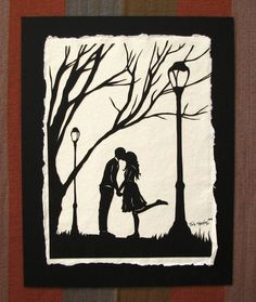 Papercut sihouette - couple kissing