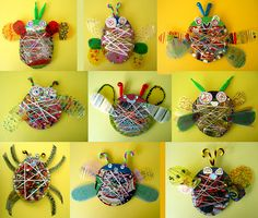 i love these more than i can say--circles and ovals of corrugated cardboard with slits cut in the circumference, cross-wound with colored threads, chenille stem bits for antennae, acetate wings decorated with permanent markers art lesson, art with yarn, bug art, craft for kids bug, cardboard projects for kids, insect, weaving projects for kids, recycled art, cardboard art projects