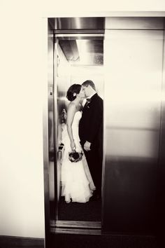 Elevator romance. Photo by Danielle #minneapolisweddingphotographer