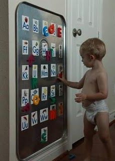 Oil drip pan from Walmart as a giant magnet board (about 12.00)- Genius!  Great idea for kids' playroom!