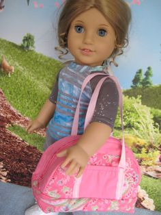"Sport bag for an 18"" doll, with zippered top opening, grosgrain straps, and two outside pockets."