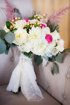 White and pink wedding bouquet wrapped in lace. #weddingchicks http://www.weddingchicks.com/2014/07/07/wedding-sign-palooza/