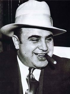 Al Capone  The gangster was one of the the most famous people in the US. Loved for running booze during the Prohibition and hated for his murderous tactics to maintain a stranglehold on his business. Pictured here with his omnipresent cigar. Date: Unknown  Photographer: Unknown.