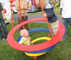 The amazing Swing-N-Spin Swring is constructed of 3 strong wooden-plastic rings plus the platform that kids can sit on, stand on, or hang from, and it swings, spins and revolves all at the same time - eSpecial Needs