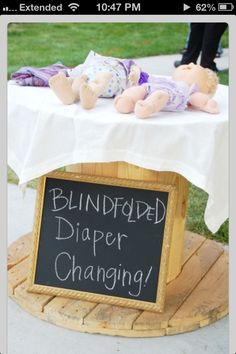 Baby shower game.Dirty diaper changing table.Diposable diapers loaded -w-mustard green relish.Quick!!! Change diaper before timer goes off!