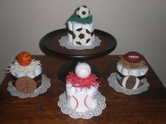 baby shower centerpieces, diaper cakes, baby boy sports theme shower, shower idea, basebal soccer