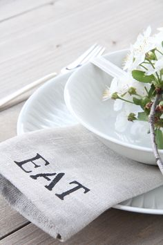 stenciled cloth napkin.  Use linen fabric and sew napkins. Then use stencils and simply paint on the word EAT using fabric paint.
