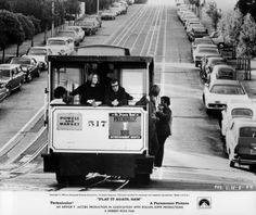 Diane Keaton and Woody Allen ride on a cable car together in a scene from the film 'Play It Again, Sam', 1972.