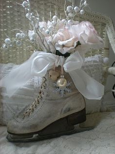 TO DO: Find old skates and recreate this lovely vignette in white and palest of pinks for holiday decor...take a photo for holiday card, as well!