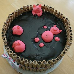 Piggy Pool Cake - I used Wilton fondant mix and too much pink dye.  Pirouline cookies from Dollar General - this was a nice thick 2 tier cake and kit kat's were too short.  For the mud I just melted store bought frosting in the microwave and poured it in. pool cake