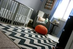 Black and white chevron rug in a modern gray nursery - we love it!
